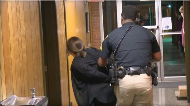 Teacher handcuffed after questioning superintendent's pay raise during school board meeting