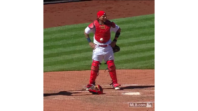 Strangest Play You'll See. Ball Gets Stuck to Yadi's Chest Protector